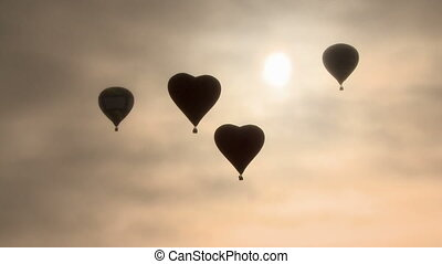Four hot air balloons flying in dawn haze