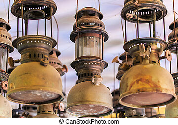 Lit hurricane lamps and lanterns or hurricane lamps