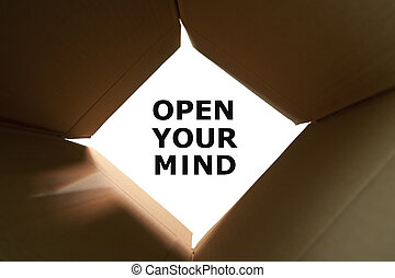 Open Your Mind Concept - Open cardboard box with text Open...
