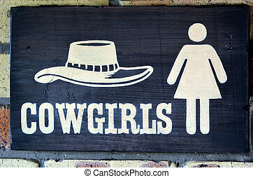 Cowgirls toilet sign and symbol, concept photo copy space