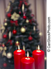 Decorated christmas tree with three candles