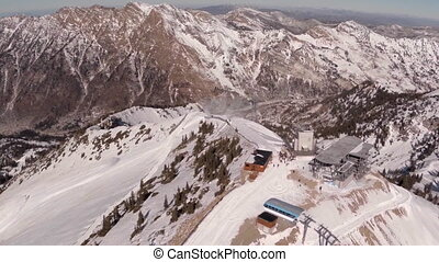 Aerial of Mountain Ridge line with People Standing by...