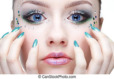 make-up - portrait of beautiful girl with strasses on the...