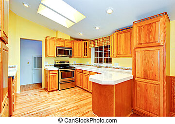 Countryside house kitchen room interior with skylights -...