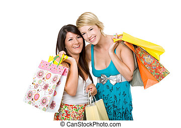 Two beautiful young women shopping. Isolated over white...