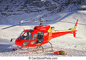 Red helicopter landed at swiss ski resort near Jungfrau...