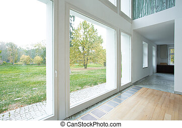 Large windows in modern house - View of large windows in...