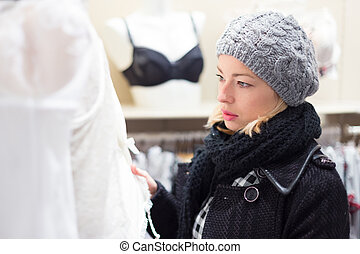 Beautiful lady shopping in lingerie store - Woman shopping...