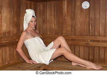 Woman relaxing in spa - Young woman relaxing in...