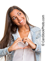 Heart - Beautiful woman making a heart shape with her hands,...