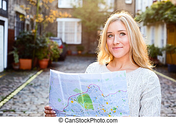 young woman holding a map