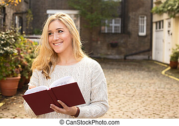 young woman holding a book.