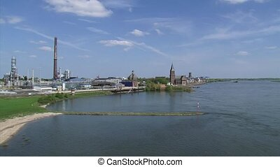 Chemical plant at riverbank pan river Rhine skyline city of...