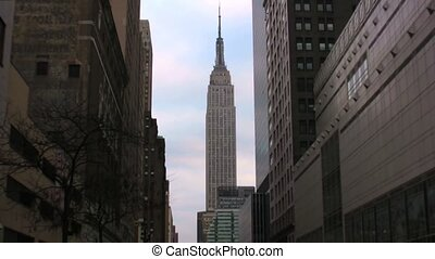 Zoom out Empire State Building downtown New York City