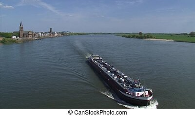 Tanker sails downstream River Rhine at Emmerich, Germany...