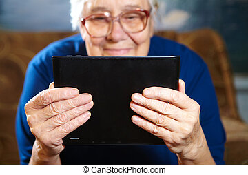 Elderly woman with tablet computer Senior people using...