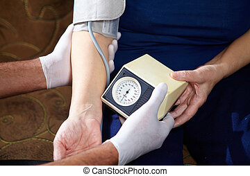 Blood pressure measuring - Senior woman measuring blood...