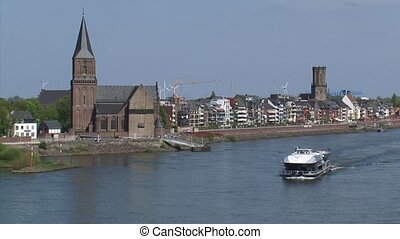 Skyline Emmerich, Germany + tourist boat cruising river...