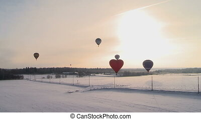 Flight of hot air balloons in winter