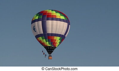 Colorful hot air balloon flying in clear sky