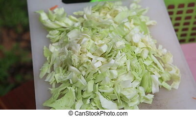 chopped cabbage lies on white board close up