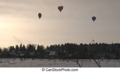 Hot air balloons flying to rural community - View of hot air...