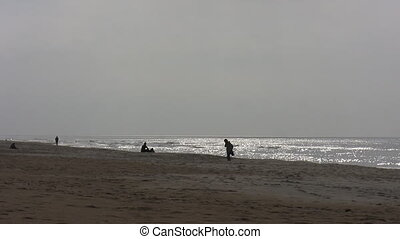 People on the beach in autumn