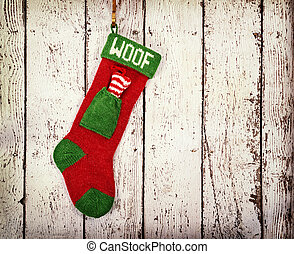Christmas stocking for a dog against vintage wood -...
