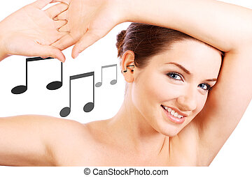 Smiling woman with music notes going in her ear - A...