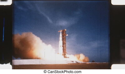Saturn V rocket liftoff. - The Saturn V was an American...