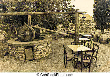 traditional Greek olive oil press in Monemvasia village,...
