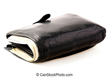 many banknotes in black wallet on light background