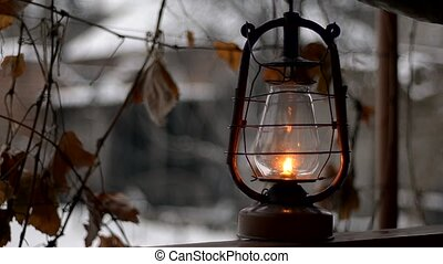 put old kerosene lamp, outdoor in winter