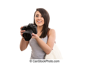 Young female tourist with camera