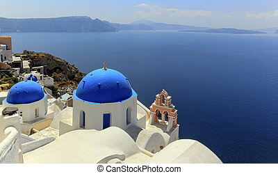 Church domes in Oia, Santorini, Greece
