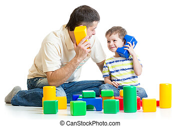 father and kid boy role-playing together isolated