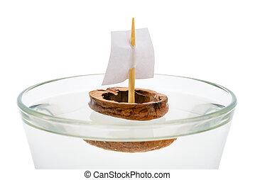 Walnut Shell Boat - Macro of a walnut shell boat with a...