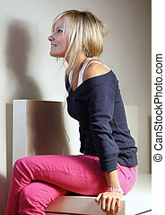 Portrait of a beautiful young woman listening to music