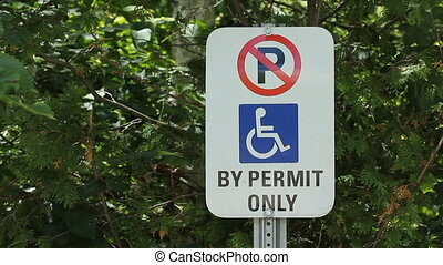 Disabled parking sign. - Disabled parking sign with foliage...