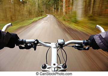 speed bicycle - man on bicycle race is driving fast