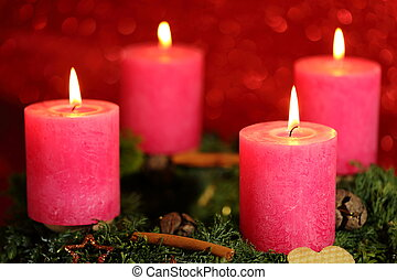 four flames on candles with red background