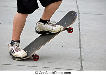 Skateboarding - Teenage boy posing with his skateboard.