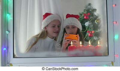 Girls reading greeting text message
