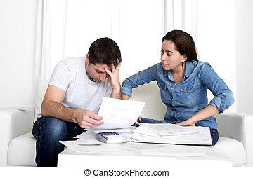 young couple worried at home in stress accounting bank...