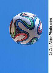 Soccer ball - Colorful World Cup soccer ball flying in air...