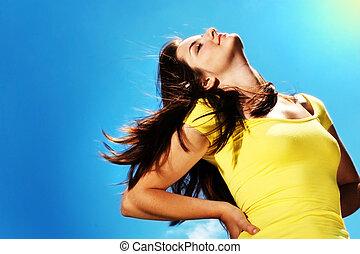 Beautiful woman enjoying the sun - A beautiful young woman...