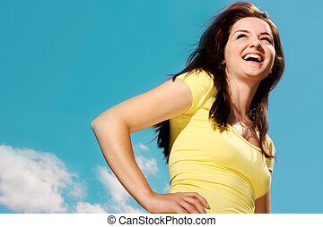 Woman smiling outdoors - A beautiful young woman smiling in...