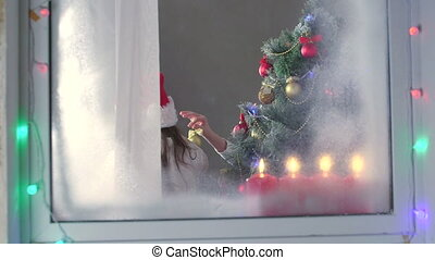 Santa Claus looking at window