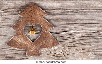 xmas tree on wooden vintage background