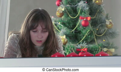 greeting text message for Christmas - Girl typing greeting...